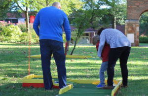 Families will enjoy playing mini golf at your car dealership